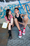 Young multi-ethnic couple reading a book. Royalty Free Stock Images
