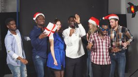 Young Multi-ethnic friends dancing at Christmas party in studio. stock video footage