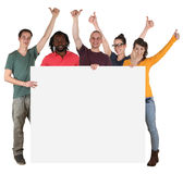 Young multi ethnic people holding empty banner with copyspace Stock Photography