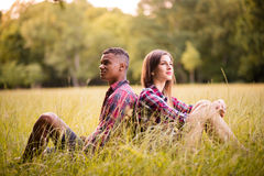Young multi racial couple turned away Royalty Free Stock Photo