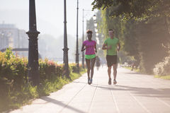 Young multiethnic couple jogging in the city Royalty Free Stock Photos