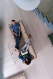Young multiethnic couple relaxes in the living room top view Royalty Free Stock Photos
