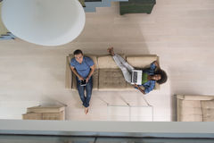 Young multiethnic couple relaxes in the living room top view Royalty Free Stock Images