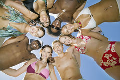 Young Multiethnic Friends Forming A Circle Royalty Free Stock Image