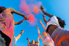 Young multiethnic friends having fun with colorful powder at holi festival of colors. Happy young multiethnic friends having fun with colorful powder at holi Stock Photography
