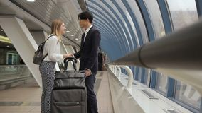 Young multiethnic people are greeting and walk along airport building indoor. stock footage