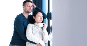 Multiethnic couple relaxing at modern home indoors Stock Photography