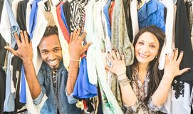 Young multiracial couple having fun at clothing flea market - Be. Young multiracial couple having fun at fashion clothing flea market - Happy people best friends stock photos