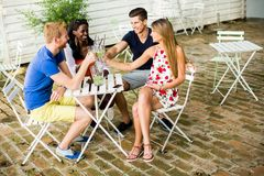 Young multiracial friends at cafe Royalty Free Stock Photo