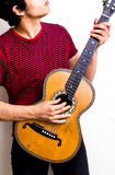 Young multiracial man playing flamenco guitar. On white background Stock Images