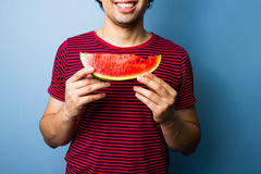 Young multiracial man with a slice of watermelon Royalty Free Stock Photo