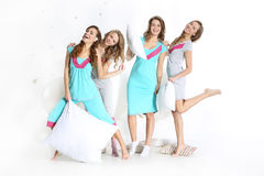 Young mum in colorful pajamas and four friends Royalty Free Stock Photography
