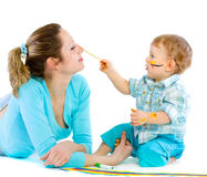 Young mum draws with the son paints Royalty Free Stock Photos