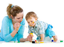 Young mum draws with the son paints Stock Images