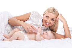 Young mum feeding small baby Royalty Free Stock Image