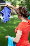 Young mum hanging the laundry. In a garden Stock Images