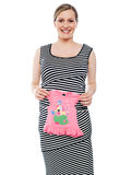 Young mum showing pink baby cloth to camera Stock Image