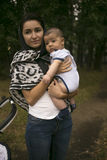 Young mum walks with baby in the park Royalty Free Stock Photography
