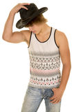 Young muscle cowboy side hold hat Royalty Free Stock Photo