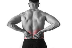 Young muscular body sport man holding sore low back waist are suffering pain in athlete stress. Young muscular body sport man holding sore low back waist with Royalty Free Stock Photography