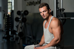 Young Muscular Caucasian Man Resting At The Bench Royalty Free Stock Photography