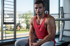 Young Muscular Caucasian Man Resting At The Bench Royalty Free Stock Image