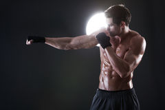 Young muscular guy with a naked torso boxing stock images