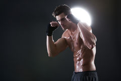Young muscular guy with a naked torso boxing Stock Photo