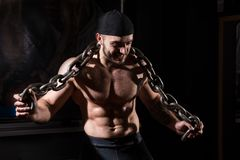 Young muscular man with chains in the gym Royalty Free Stock Photography