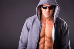 Young muscular man in dark glasses. Stock Photos
