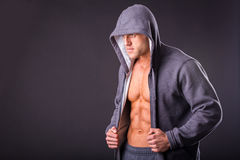 Young muscular man in dark glasses. Royalty Free Stock Photo