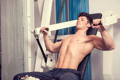 Young muscular man exercising in the gym Stock Image