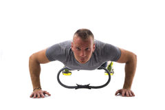 Young muscular man exercising with Pilates ring isolated on white Royalty Free Stock Photos