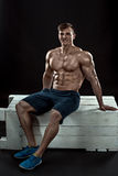 Young Muscular man flipping box royalty free stock photo