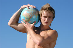 Young Muscular Man with a Globe Stock Photos