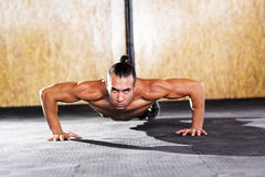 Young muscular man in gym Stock Images
