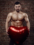 Young muscular man with heart royalty free stock photography