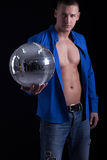 Young muscular man holding disco ball Royalty Free Stock Photo
