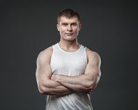 Young muscular man isolated on gray background Royalty Free Stock Photography