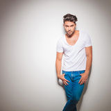 Young muscular man in jeans standing and looking at the camera Royalty Free Stock Photography
