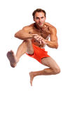 Young muscular man jumping against white Royalty Free Stock Images