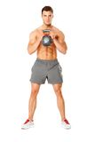Young muscular man lifting weights on white Royalty Free Stock Image
