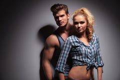 Young muscular man looking away near girlfriend Stock Photography