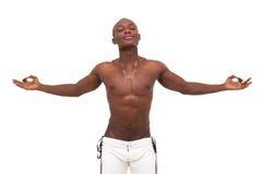 Young muscular man meditating Stock Image