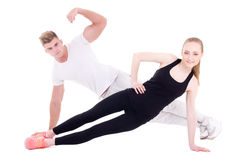 Young muscular man and slim woman doing fitness exercises isolat Royalty Free Stock Photography