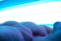 Young Muscular Man At Solarium In Beauty Salon Stock Photography