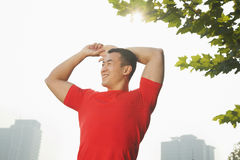 Young Muscular Man Stretching Stock Photos