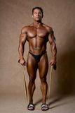 Young muscular man training with elastic band Royalty Free Stock Photography