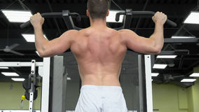 Young muscular man trains at the gym. athlete of weight training stock photo