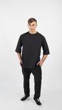 Young muscular man wearing black clothes and sneakers Royalty Free Stock Photo